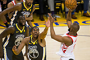 Golden State Warriors forward Kevon Looney (5) attempts to block a Houston Rockets shot during Game 4 of the Western Conference Finals at Oracle Arena in Oakland, Calif., on May 22, 2018. (Stan Olszewski/Special to S.F. Examiner)