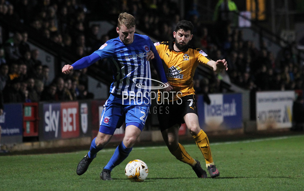Piero Mingoia of Cambridge United and Scott Harrison of Hartlepool United in action during the EFL Sky Bet League 2 match between Cambridge United and Hartlepool United at the Cambs Glass Stadium, Cambridge, England on 14 March 2017. Photo by Harry Hubbard.