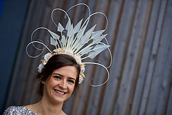 LIVERPOOL, ENGLAND - Thursday, April 6, 2017: Nicola Magee, 26 from County Down, Ireland, wearing a feathered fascinator, during The Opening Day on Day One of the Aintree Grand National Festival 2017 at Aintree Racecourse. (Pic by David Rawcliffe/Propaganda)