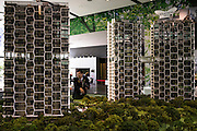 A salesman shows off the architectural models for high-rise serviced apartments that boast many sustainable-living features built into the architecture, including a number of sky parks and hanging gardens. Photo by Suzanne Lee/Panos Pictures
