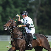 Mariano Aguerre, White Birch, in action during the White Birch Vs K.I.G Polo match in the Butler Handicap Tournament match at the Greenwich Polo Club. White Birch won the game 11-8. Greenwich Polo Club,  Greenwich, Connecticut, USA. 12th July 2015. Photo Tim Clayton