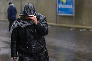 Football supporters arriving at American Express Community Stadium in the wind and rain ahead of the Premier League match between Brighton and Hove Albion and Norwich City at the American Express Community Stadium, Brighton and Hove, England on 2 November 2019.