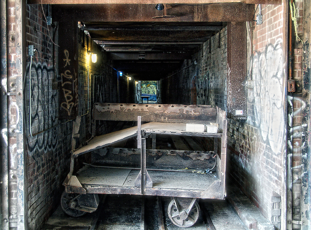 Carts were used to move bricks in and out of drying tunnels and kilns, part of the Holcim Gallery, Evergreen Brick Works, Toronto (Canada).<br /> <br /> &ldquo;Building 16&rdquo; at the Brick Works housed several massive kilns built in the 1960s for firing and drying bricks. The kilns were fascinating artifacts, but their sheer size &ndash; 600 linear metres occupying three-quarters of the building &ndash; made the space impossible to use.<br /> <br /> Dissecting the kilns to reveal their hidden spaces and internal workings, opened up the building, providing space for a large-scale contemporary venue (Holcim Gallery), and at the same time tells the story of this historic space.<br /> <br /> Visitors can now access and explore the various interior spaces of the kilns, and learn about the different stages of firing brick: preheating, firing, and cooling. The rich, industrial masonry of this site is brought to life by a simple but strategic process of deconstruction and interpretation.