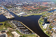 Nederland, Groningen, Gemeente Groningen, 01-05-2013; Oosterhogebrug, met woonschepenhaven en woontoren Tasmantoren, de binnenstad in de achtergrond. Knooppunt van waterwegen: Eemskanaal (onder en links), begin van Van Starkenborghkanaal met Oostersluis.<br /> View on the city of Groningen, residential tower Tasmantoren , Eemskanaal crossing Van Starckenborghkanaal (channels) and business park. <br /> luchtfoto (toeslag op standard tarieven)<br /> aerial photo (additional fee required)<br /> copyright foto/photo Siebe Swart