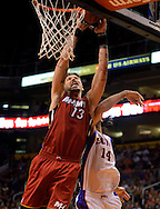 Nov. 17, 2012; Phoenix, AZ, USA; Miami Heat forward Mike Miller (13) puts up the ball during the game against the Phoenix Suns forward Luis Scola (14) in the first half at US Airways Center. Mandatory Credit: Jennifer Stewart-US PRESSWIRE.