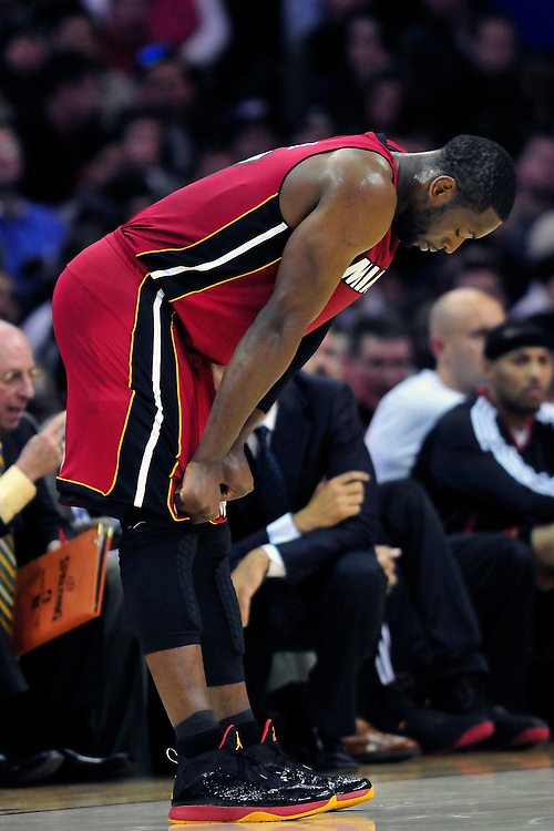 March 29, 2010; Cleveland, OH, USA; Miami Heat shooting guard Dwyane Wade (3) hangs his head during the fourth quarter against the Cleveland Cavaliers at Quicken Loans Arena. The Cavaliers beat the Heat 102-90. Mandatory Credit: Jason Miller-US PRESSWIRE