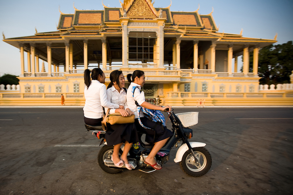 Schoolgirls on a Honda Chaly, in front of the Royal Palace in Phnom Penh, Cambodia