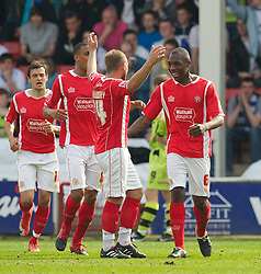 WALSALL, ENGLAND - Saturday, April 10, 2010: Walsall's Emmanuele Smith celebrates scoring in the 'right' end after he equalised his own-goal against Tranmere Rovers during the Football League One match at the Bescot Stadium. (Photo by David Rawcliffe/Propaganda)