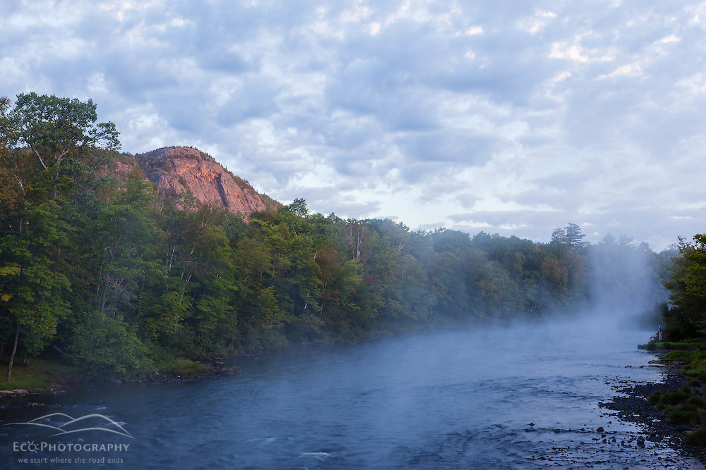 Morning mist rises from the East Branch of the Penobscot River near Matagamon Wilderness Camps and the International Appalachian Trail. Horse Mountain.