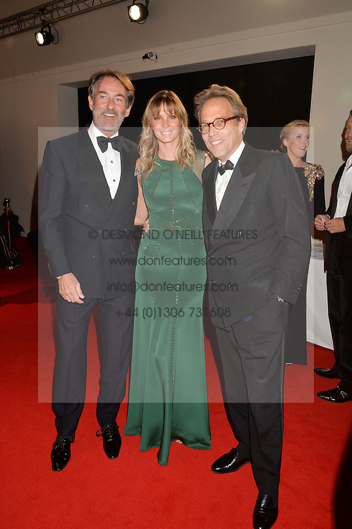 Left to right, TIM & MALIN JEFFERIES and the EARL OF MARCH at the IWC Schaffhausen Gala Dinner in honour of the British Film Institute held at the Battersea Evolution, Battersea Park, London on 7th October 2014.