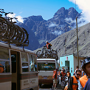 "Mountain Biking on Death Road, Bolivia...A tour group of Mountain Bikers stop to rest and be briefed about the next stage of the journey by their tour leader...The North Yugas Road is a 64 Kilometer road leading from La Paz to Corioico. It is legendary for it's extreme danger and in 1995 the Inter American Development Bank christened is as the ""world's most dangerous road"".. The road was built in the 1930's during the Chaco War by Paraguayan prisoners to connect the Amazon rainforest region of Northern Bolivia to it's capital City La Paz. One estimate is that 200 to 300 travelers were killed yearly along the road. On 24 July 1983, a bus veered off the Yungas Road and into a canyon, killing more than 100 passengers in what is said to be Bolivia's worst road accident..A new stretch of the La Paz-Coroico highroad was opened in 2006 to bypass the notorious stretch known as death road..The danger of the road has now made it a popular tourist destination starting in the 1990's and drawing thrill-seekers and mountain bike enthusiasts who ride on the 64km mainly downhill stretch from La Cumbre, a 4,700 meter peak to Yolosa, a decent of 3600 meter's (11,800 feet). The journey includes breathtaking views of snow covered peaks and towering cliffs and starts along modern asphalted road before entering the jungle itself and the most dangerous and notorious part of the ride. The infamous narrow dirt road, most of the road no wider than 3.2 meter's, is cut into the side of the mountain with sheer drops to the left of up to 600 meter's with virtually no safety rails on the winding steep decent..There are now many tour operators catering to this activity, providing information, guides, transport and equipment. Nevertheless, the Yungas Road remains dangerous. At least 13 of these cyclists died on the ride since 1998, the latest A 28-year-old Israeli traveler was killed in April 2010  the group of cyclists arrived at a heavily foggy area. The woman got separated from the group, and fe"