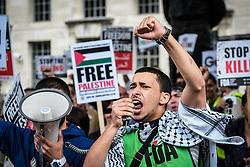 Pro-Palestinian protesters demonstrate outside Downing street against arms sales to Israel. August 2014 London UK
