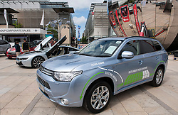 © Licensed to London News Pictures. 06/06/2015. Bristol, UK.  A Mitsubishi Outlander GX4h 2.0 PHEV Auto at a display of electric, hybrid, and low emission vehicles at Bristol's Millennium Square sponsored by EDF energy.  The cars are engineered to produce no or low emissions and pollution to reduce the impact of transport on the environment.  Photo credit : Simon Chapman/LNP