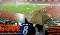 23.07.2011, Rajamangala National Stadium, Bangkok, THA, Chelsea FC Asia Tour, Training, im Bild // Fans watch the Chelsea players training during a torrential downpour of rain during a training session at Rajamangala National Stadium in Bangkok on the club's preseason Asia Tour, EXPA Pictures © 2011, PhotoCredit: EXPA/ Propaganda/ D. Rawcliffe *** ATTENTION *** UK OUT!