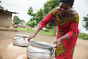 Kihouala Koné, 51, cooking outside the restaurant she owns in the town of Katiola, Cote d'Ivoire on Friday July 12, 2013. Kihouala underwent FGM as a child. She encourages other women in her community to speak out about their experience to help end the practice.