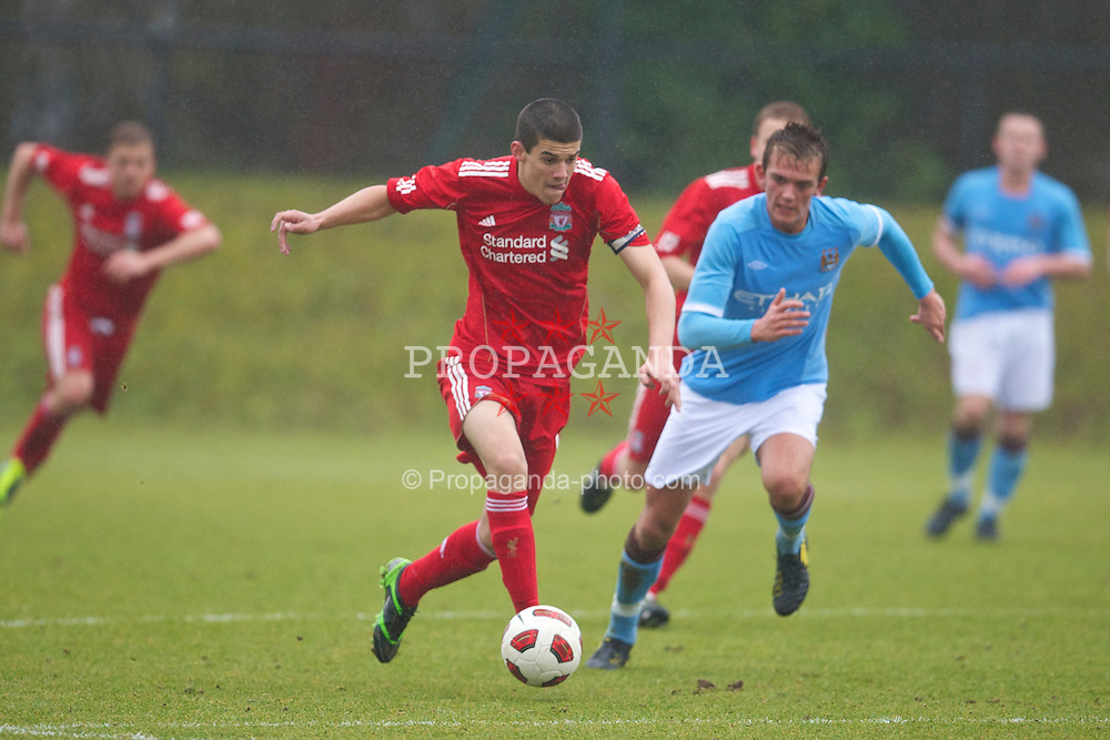 KIRKBY, ENGLAND - Saturday, February 5, 2011: Liverpool's captain Conor Coady in action against Manchester City's Emyr Huws during the FA Academy Under 18s League at the Kirkby Academy. (Photo by David Rawcliffe/Propaganda)