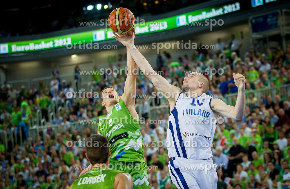Jaka Lakovic of Slovenia vs Tuukka Kotti #10 of Finland during basketball match between National teams of Slovenia and Finland in Round 2 at Day 13 of Eurobasket 2013 on September 16, 2013 in Arena Stozice, Ljubljana, Slovenia. (Photo by Vid Ponikvar / Sportida.com)