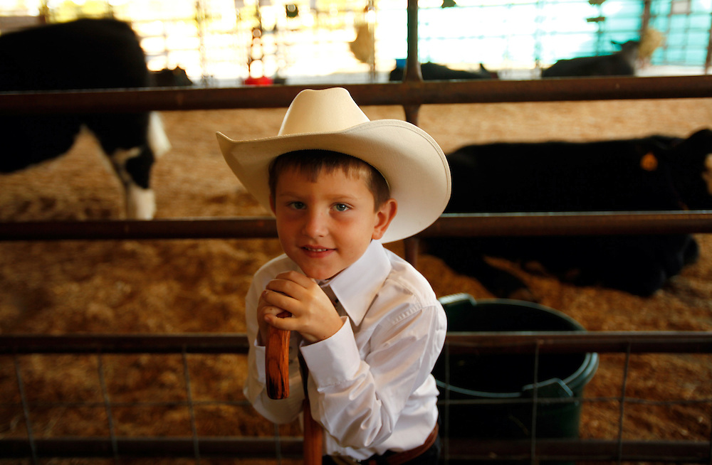 Five-year-old Zach Caron, of Naples, waits to participate in the Pee Wee Show livestock competition at the Collier County Fair on Sunday, Feb. 7, 2010. The Pee Wee Show teaches children under the age of eight the guidelines of participating in livestock shows. The 34th annual fair continues through Feb. 14. David Albers/Staff