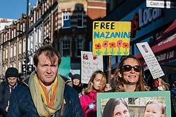 "© Licensed to London News Pictures. 25/11/2017. London, UK. Richard Ratcliffe (L), husband of British Iranian Nazanin Zaghari-Ratcliffe who remains in prison in Iran, joins protesters as they deliver a ""Mothers Open Letter"" to His Excellency Sayyed Ali Hosseini Khamenein calling for her immediate release. Photo credit: Rob Pinney/LNP"
