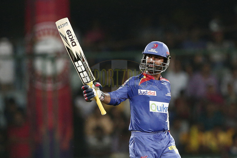Dinesh Karthik of the Delhi Daredevils celebrate his fifty during match 26 of the Pepsi Indian Premier League Season 2014 between the Delhi Daredevils and the Chennai Superkings held at the Ferozeshah Kotla cricket stadium, Delhi, India on the 5th May  2014<br /> <br /> Photo by Deepak Malik / IPL / SPORTZPICS<br /> <br /> <br /> <br /> Image use subject to terms and conditions which can be found here:  http://sportzpics.photoshelter.com/gallery/Pepsi-IPL-Image-terms-and-conditions/G00004VW1IVJ.gB0/C0000TScjhBM6ikg