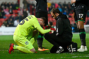 Sid Nelson (25) of Yeovil Town being treated for a wrist injury in the first half during the EFL Sky Bet League 2 match between Swindon Town and Yeovil Town at the County Ground, Swindon, England on 10 April 2018. Picture by Graham Hunt.