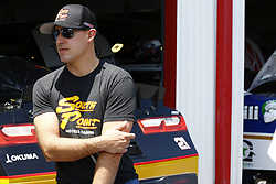 April 27, 2018 - Talladega, Alabama, United States of America - Daniel Hemric (21) hangs out in the garage during practice for the Spark Energy 300 at Talladega Superspeedway in Talladega, Alabama. (Credit Image: © Chris Owens Asp Inc/ASP via ZUMA Wire)