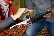 Asma Yunidar going through her books with her husband, Fauzan Yunidar.<br /> <br /> Asma runs her own snack business, making pasties, donuts, crisps and other snacks from her small home kitchen. <br /> <br /> After attending the business training she learnt how to keep her books accurately and she has now realised she earns more than her husband.