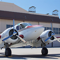 A Handsome Twin Beechcraft 18 sits on the ramp gleaming in the morning high desert sun awaiting an afternoon flight.