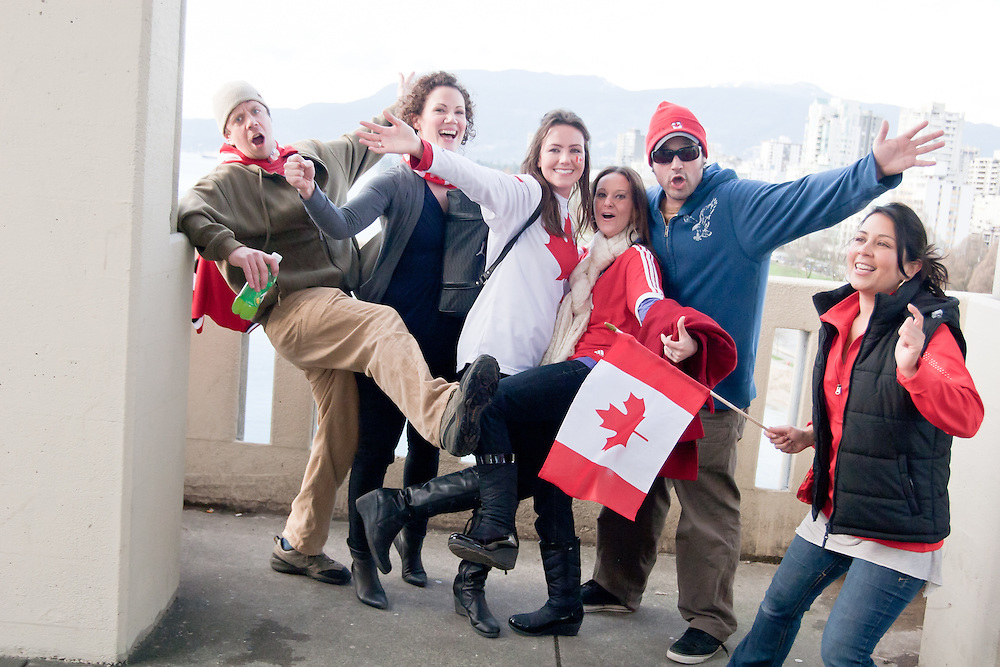 A group of friends pose for a photograph on Burrard bridge as they head towards the celebrations downtown.<br /> <br /> Tens of thousands of people in Vancouver took to the streets on Sunday 28th February 2010 to celebrate Canada's 3-2 overtime win over the United States for the gold medal in men's Olympic hockey...Traffic came to a halt in and around the downtown of the host city for the Winter Games following the dramatic finish to the match, which featured Sidney Crosby scoring to secure the victory on the final day of Olympic competition.