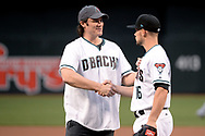 PHOENIX, AZ - APRIL 07:  American country music artist Joe Nichols shakes hands with Chris Owings #16 of the Arizona Diamondbacks after throwing out the ceremonial first pitch for the MLB game between the Cleveland Indians and Arizona Diamondbacks at Chase Field on April 7, 2017 in Phoenix, Arizona.  (Photo by Jennifer Stewart/Getty Images)
