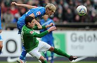 FUSSBALL   1. BUNDESLIGA   SAISON 2011/2012   21. SPIELTAG Werder Bremen - 1899 Hoffenheim                        11.02.2012 Andreas Beck (hinten, TSG 1899 Hoffenheim) gegen Zlatko Junuzovic (orn, Bremen)