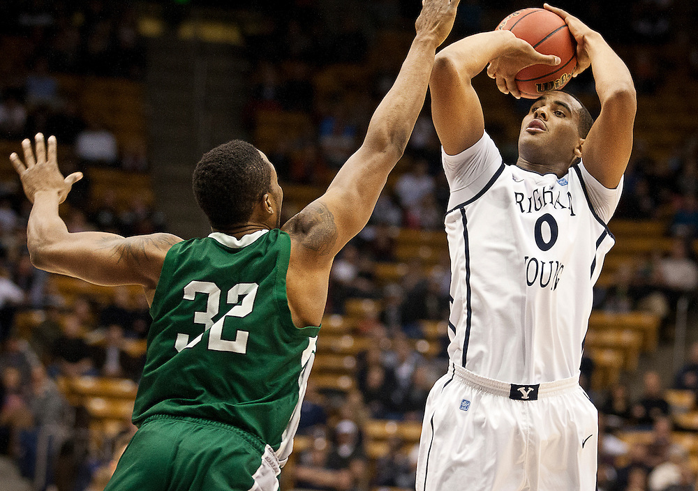 BYU forward Brandon Davies (0) shoots a jump shot over Eastern New Mexico forward Phil Henry (32) during the first half of the NCAA basketball game between the BYU Cougars and the Eastern New Mexico Greyhounds at the Marriott Center, Tuesday, Dec. 18, 2012.