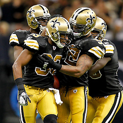 September 25, 2011; New Orleans, LA, USA; New Orleans Saints cornerback Jabari Greer (33) celebrates with teammates following an interception against the Houston Texans during the fourth quarter at the Louisiana Superdome. The Saints defeated the Texans 40-33. Mandatory Credit: Derick E. Hingle