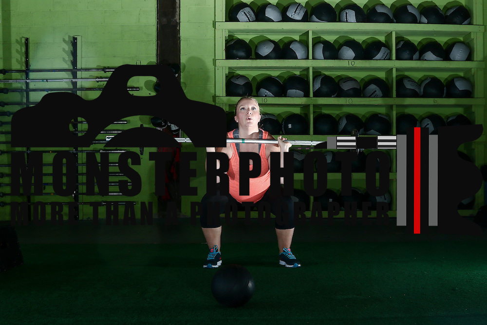 Katie Hemming who is 6 and a half months pregnant performs squats during a CrossFit class Thursday, August 18, 2016, at CrossFit Riverfront in Wilmington.