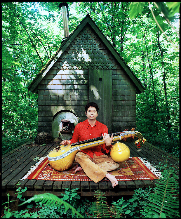 Jeff Trott (Sheryl Crow, Wire Train) with sitar. Photographed at his home in Portland, Oregon 2001.<br />