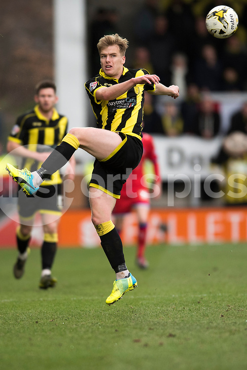 Damien McCory of Burton Albion attempts to control the ball during the Sky Bet League 1 match between Burton Albion and Oldham Athletic at the Pirelli Stadium, Burton upon Trent, England on 26 March 2016. Photo by Brandon Griffiths.