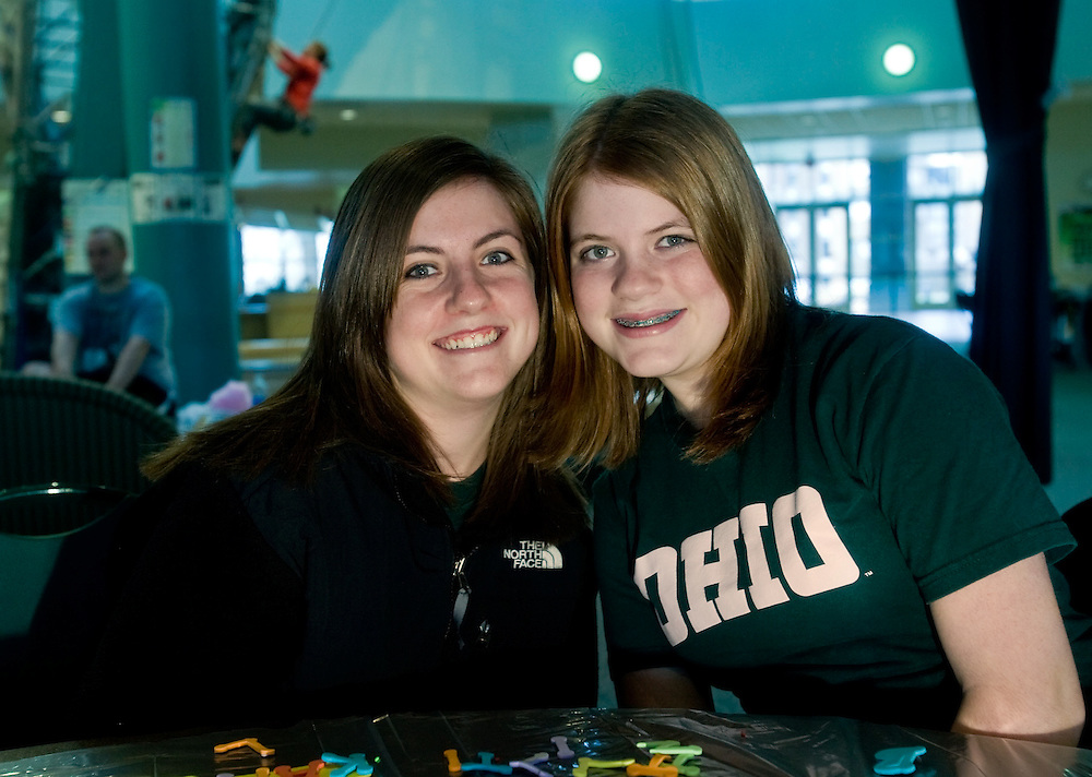 OU's Monica Southworth, left, hangs out with her sister Kaitlin Southworth at Rec Fest during sibs weekend at Ping Recreation Center. photo by Kevin Riddell