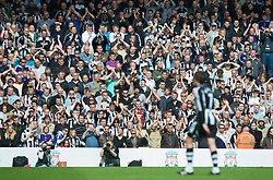 LIVERPOOL, ENGLAND - Sunday, May 3, 2009: Some Newcastle United supporters applaud, other shout abuse as Joey Barton walks off dejected as he is sent off during the Premiership match against Liverpool at Anfield. (Photo by David Rawcliffe/Propaganda)
