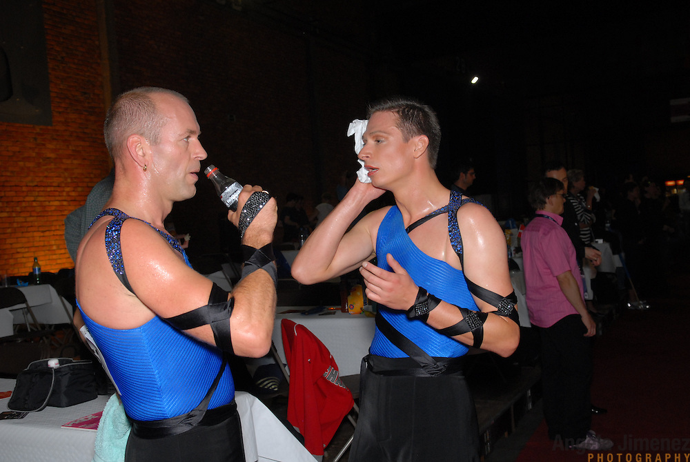 Rainer Dietzel, left, and Thomas Bensch, both of Germany, cool down after competing in the same-sex ballroom dancing competition during the 2007 Eurogames at the Waagnatie hangar in Antwerp, Belgium on July 13, 2007. ..Over 3,000 LGBT athletes competed in 11 sports, including same-sex dance, during the 11th annual European gay sporting event. Same-sex ballroom is a growing sports that has been happening in Europe for over two decades.