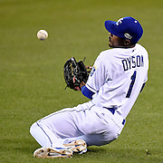 Kansas City Royals center fielder Jarrod Dyson dives and blocks a hit by San Francisco Giants catcher Buster Posey in the sixth inning in Game 2 of the World Series on Wednesday, October 22, 2014, at Kauffman Stadium in Kansas City, Mo.