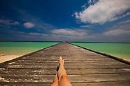 Long Pier and Ocean, Indonesia Kalimantan Borneo Sangalaki Derawan Island with Woman's Legs