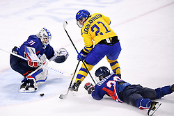 PYEONGCHANG, Feb. 12, 2018  Shin So Jung (L), goalkeeper of the unified team of the Democratic People's Republic of Korea (DPRK) and South Korea defends against Sweden's forward Erica Uden Johansson during their preliminary match of women's ice hockey at the Pyeongchang 2018 Winter Olympic Games at the Kwandong Hockey Centre in Gangneung, South Korea, on Feb. 12, 2018. The unified team of the Democratic People's Republic of Korea (DPRK) and South Korea lost 0:8. (Credit Image: © Ju Huanzong/Xinhua via ZUMA Wire)