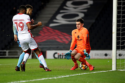 Coventry City's Maxime Biamou scores his goal through the legs of MK Dons keeper Lee Nicholls during the Emirates FA Cup  Fourth Round match at  Stadium MK Milton Keynes