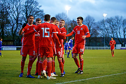 BANGOR, WALES - Tuesday, November 20, 2018: Wales' Lewis Collins (hidden) celebrates scoring the first goal with team-mates Brennan Johnson, Jack Vale, Ryan Astley, Sam Bowen, Ryan Stirk and Daniel Griffiths during the UEFA Under-19 Championship 2019 Qualifying Group 4 match between Wales and San Marino at the Nantporth Stadium. (Pic by Paul Greenwood/Propaganda)