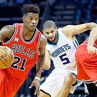 03 November 2015: Chicago Bulls guard Jimmy Butler (21) drives past Charlotte Hornets forward Nicolas Batum (5) on a screen set by Chicago Bulls center Joakim Noah (13) during the Charlotte Hornets  130-105 victory over the Chicago Bulls, at the Time Warner Cable Arena, in Charlotte, North Carolina, USA.