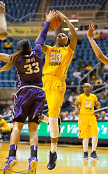 West Virginia Mountaineers guard Bria Holmes (23) shoots over TCU Horned Frogs guard Donielle Breaux (33) at the WVU Coliseum.
