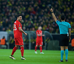 DORTMUND, GERMANY - Thursday, April 7, 2016: Liverpool's Emre Can is shown a yellow card by referee Carlos Velasco Carballo during the UEFA Europa League Quarter-Final 1st Leg match against Borussia Dortmund at Westfalenstadion. (Pic by David Rawcliffe/Propaganda)