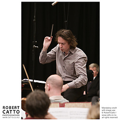 The NZSO perform with conductor Hamish McKeich at the Todd Foundation Young Composers readings in the Wellington Town Hall, New Zealand.