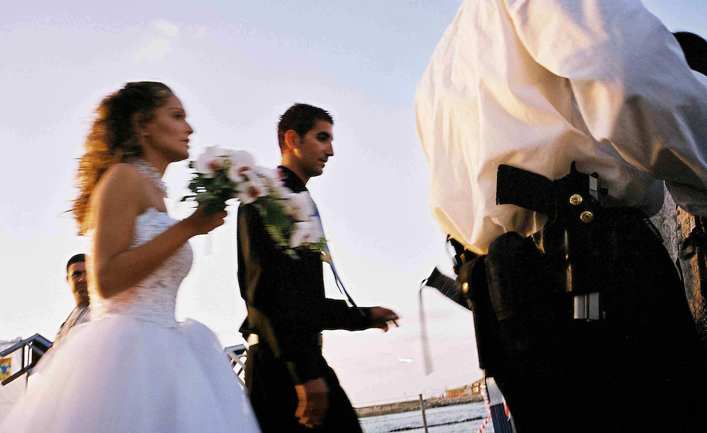 Yung couple before the weeding getting to the old port of Tel Aviv to see the sun set, stops for security checking,....Tel -Aviv 2002
