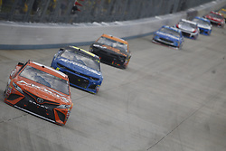October 7, 2018 - Dover, Delaware, United States of America - Daniel Suarez (19) battles for position during the Gander Outdoors 400 at Dover International Speedway in Dover, Delaware. (Credit Image: © Justin R. Noe Asp Inc/ASP via ZUMA Wire)